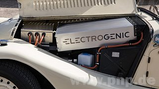 The battery and power electronics are also located under the long hood